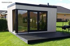 This modern timber garden room stands out in any garden because of its clean lines and contemporary style. But this customer photo shows the Esk garden room with a white stain on the walls and black paint around the windows and on the decking, making for an ultra-modern garden room. The black decking is inspired - imagine how a few blue plant pots or some green deck chairs would stand out!