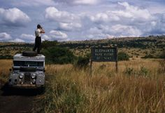 Uganda. 1958. Queen Elizabeth National Park. 'Elephants have Right of Way' sign on crater lake track. (1958), George Rodger
