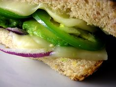 Mexican grilled cheese sandwich (with avocado, jalapeno, and red onions)