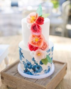 Small 2-tier hand-painted cake and flower garnishes. #paintedwedding #paintedcake #weddingcake #cake #hisandhersconfections #watercolourcake
