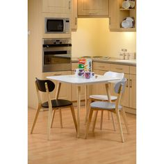 The Julian Dining Table is a simplistic yet elegant squared four legged dining table with a white top surface and rubber wood legs with a natural finish.