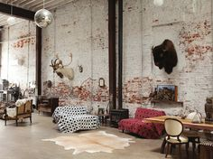 taxidermy disco. love the mix. love exposed brick.