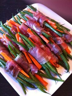 blanched haricots verts and sliced carrots wrapped in prosciutto