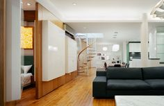 West 17th St. Loft: Living room with bedroom behind pivoting wall (photo: Michael Moran)