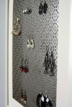 Jewelry organizer... made from a decorative radiator grate and a picture frame:)