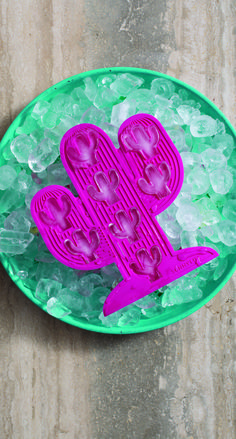 Take your summer drinks collection to the next level with this Set of Two Cactus Ice Trays.