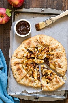 Easier than pie! Apple Butter Galette is an open-faced pie made with homemade pie crust, apple butter, fresh apple slices, and walnuts. Made with @MussAppleButter