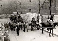 Distribution of matzos (unleavened bread) by the ZSS in Warsaw during Passover 1940. Yad Vashem Photo Archives FA 33/1852