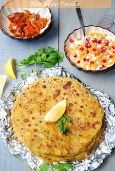 Aloo Paratha ~ hot, flaky Indian flatbread stuffed with with spicy potato and peas filling, cooked on a griddle
