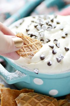 This cannoli dip is creamy and sweet, perfectly balanced with the flavor and texture of the ricotta. Enjoy with pizzelle cookies, strawberries, and grapes!
