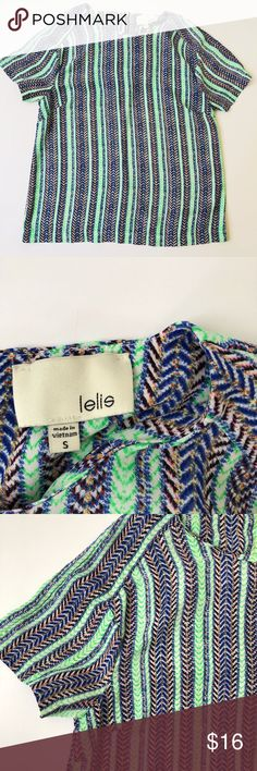 Lelis Striped Top Sz Small 35 inches around at armpits with darts Top is 22 inches long Exposed zipper in back Short sleeves Beautiful vivid colors Excellent condition Freshly washed Smoke/Pet Free I ship item on the next day 99% of the time A great item to add to your spring/summer closet! lelis Tops Blouses