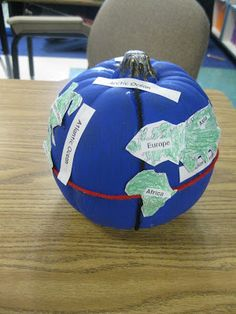 214 construct a globe depicting the four hemispheres seven third grade thinkers pumpkin globes i like this much more than trying to have them paint the continents on use blow up ball instead of pumpkin sciox Choice Image