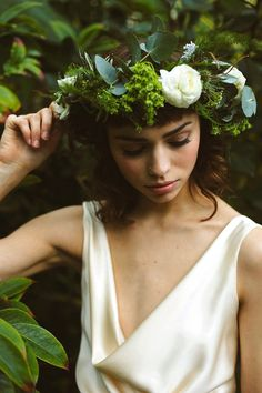 An ethereal and elegant botanical winter wedding inspired photoshoot.  Shot on location at Sheffield Botanical Gardens and styled and photographed by Shelley Richmond.  The gowns are by independent designer Kate Beaumont.