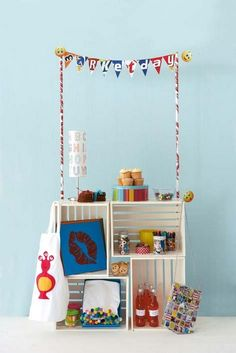 love the wooden crates stacked to make the counter! Cute for a lemonade stand or cupcake stand. Disassemble and use the crates for storage in kids room.