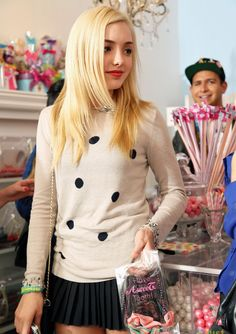 Peyton List in a cute outfit, in a candy store, wearing a rainbow loom bracelet. That's cool!