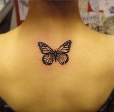 Black Upper Back Butterfly Tattoo