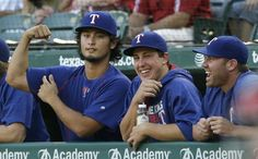 Yu Darvish jokes around with Derek Holland and Colby Lewis in the dugout during a game against the Cleveland Indians Thursday, Aug. 25, 2016. They had just watched a video replay of Darvish's home run from the night before. (AP Photo/LM Otero)
