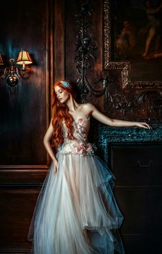 Fantasy art editorial photography red hair girl, female full body haute couture luxury high fashion editorial portrait in the old baroque wooden hall. Ginger, red head woman in white veil wedding dress in a dark contrasted color photo, picture in center composition