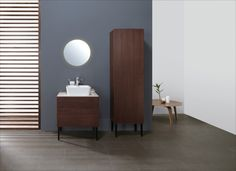 Accessorize the NOCE collection with wheel cabinets and side cabinets for the bathroom.