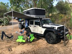 Jeep Wrangler with roof tent James Baround and side shading