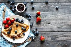Delicious Crepes Breakfast with Dramatic light over a vintage wood background. An healthy meal of Pancakes with marmalede, blueberries and strawberries. Breakfast Crepes, Crepe Maker, Les Allergies, Food Photography Tips, Blueberry, Pancakes, Strawberry, Healthy Recipes, Meals