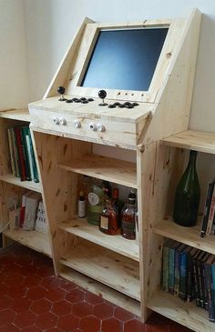 Game design 505458758175339824 - DIY creation of an arcade cabinet combining video games, bar and library. A modern and very personal interpretation of the arcade cabinet. Retro Game, Retro Arcade, Mini Arcade, Nerd Room, Gamer Room, Diy Arcade Cabinet, Deco Gamer, Bartop Arcade, Arcade Table