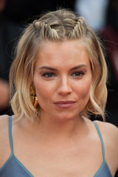 Consider going for subtle braid accents à la Sienna Miller, who wore her hair in undone waves and parted in the middle. To add a little something extra, create two mini French braids on either side of your part, stopping at the crown of your head, and secure each end with a clear elastic.