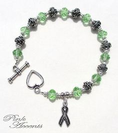 Non-Hodgkin's Lymphoma Awareness: Green Glass and Sterling Silver Plated Bracelet, 8.75 inches.  30% of your purchase price goes directly to the Lymphoma Research Foundation!  LRF is the nation's largest non-profit organization devoted exclusively to funding innovative lymphoma research and providing people and healthcare professionals with up-to-date information about this type of cancer.