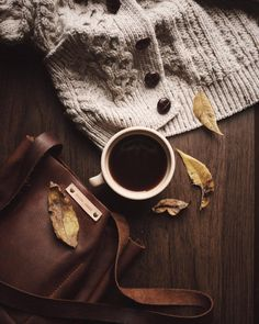 Love this autumnal inspired photo. The autumn colours, the cosy cardigan, the hot drink and autumn leaves.