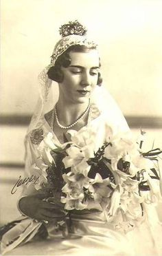 Queen Ingrid of Denmark, mother of the present queen, on the occasion of her marriage.  Ingrid was a Swedish princess, first cousin once removed of Princess Astrid who became Queen of the Belgians.  She too wore one of these little crowns which seem to have been worn by all the Swedish princesses.