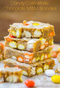 Candy Corn White Chocolate M&M Blondies - Super soft & moist blondies stuffed with those cult favorite candy corn M&Ms! Fast, Easy, One-Bowl, No-Mixer Recipe at averiecooks.com