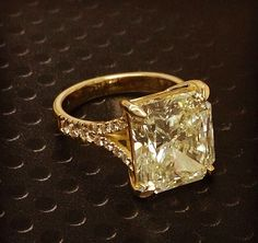 Absolutely beautiful! I would love to have a ring like this for my new wedding ring.  Champagne stone (?), the diamonds, just perfect.