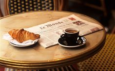 The food of Paris: le petit dejeuner, Paris style. Le Monde of course, but Harris yearns for the New York Times, or a least a London newspaper. And how's man supposed to survive on that bit of bread, he wonders? He slugs back the espresso and heads off to find a thick slice of ham, some cheese and a baguette to begin his day.