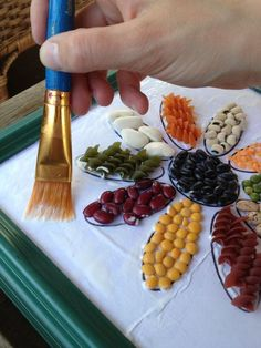 """I made this project for my daughter's Girl Scout Troop for a project in being resourceful. After reading """"Clover's Story"""" we used leftover dried beans, rice & pasta and… Daisy Girl Scouts, Girl Scout Troop, Seed Craft, Pasta Crafts, Pasta Art, Daisy Art, Girl Scout Activities, Bible School Crafts, Girl Scout Crafts"""
