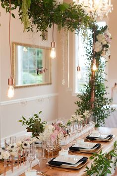 For a wedding with a modern look - A trellis of greenery, square white plates, black linens and copper details ~ https://www.insideweddings.com/weddings/urban-chic-styled-wedding-shoot-with-unique-copper-accents/785/