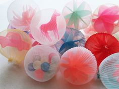 Ethereal Sculptures and Wearable Orbs Formed From Synthetic Fabric by Mariko Kusumoto