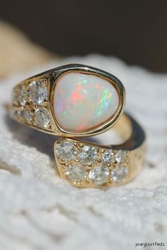 Opal, Diamond and luxurious gold.