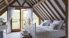 White Country Bedroom with Oak Beamed Ceiling