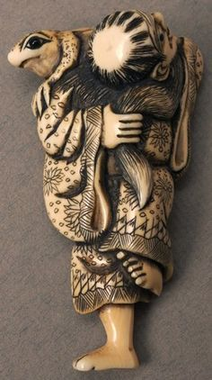 Ivory Netsuke depicting a Chinese holy man or Sennin with a toad on his shoulder.