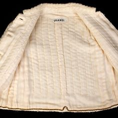 "Inside a Chanel jacket. From Kent State University Museum's ""Inside Out: Revealing Clothing's Hidden Secrets"" exhibit. More jacket photos on their blog for all you Chanel jacket fans. #Chaneljacket @ksmuseum"