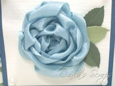 Ribbon Rose Tutorial--this looks like it will work with a fabric back too.