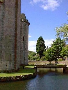 photo of Nunney Castle that includes the restored moat. The original drawbridge was replaced with a footbridge in later years.