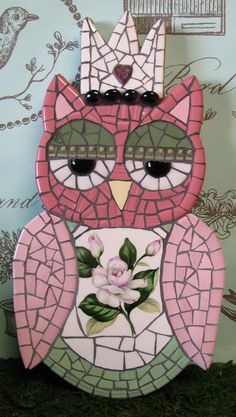 I like the cartoony style of this owl, but I wouldn't put an old wierd flower in it like this - Keep it cute!