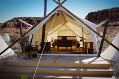 Take in the dramatic red rock surroundings of the desert like you never have before. Stay Under Canvas and connect to the great outdoors. {photo courtesy of Moab Under Canvas}