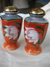 orange lustre salt and pepper shaker set from the These sweet little shakers are hand painted with an orange background, with a beautiful white hibiscus Pepper Spice, Salt N Pepper, Salt Pepper Shakers, White Hibiscus, China Sets, Orange Background, Modern Ceramics, Luster, Ceramic Art