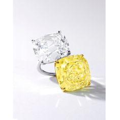 Impressive Fancy Intense Yellow Diamond and Diamond Ring. Of toi et moi design, set with a carat cushion-shaped fancy intense yellow diamond and a carat cushion-shaped Type IIa diamond, mounted in platinum and 18 karat yellow gold. Trendy Jewelry, Jewelry Accessories, Fine Jewelry, Jewelry Design, Jewellery Box, Diamond Jewelry, Diamond Earrings, Jewelry Stores Near Me, Yellow Diamond Rings