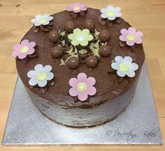 Chocolate Birthday Cake decorated with ganache, maltesers and wafer daisies.