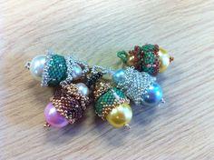 Beaded acorn charms based on Nancy Cain's 'pearl romance' design from Beadwork August-September 2009.