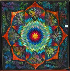 "Mandala collage by Lani Mandala is a Sanskrit word that means ""circle"" and in the Hindu and Buddhist traditions their sacred art often. Mandala Art, Mandala Pattern, Star Quilt Patterns, Star Quilts, Lone Star Quilt Pattern, Psy Art, Applique Quilts, Fabric Art, Sacred Geometry"