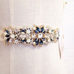 But green.  Swarovski Crystal Bridal Belt- Custom Bridal Belt- Swarovski Crystal Bridal Sash- Saphhire and Gold Bridal by HelenaNoelleCouture on Etsy https://www.etsy.com/uk/listing/225785304/swarovski-crystal-bridal-belt-custom